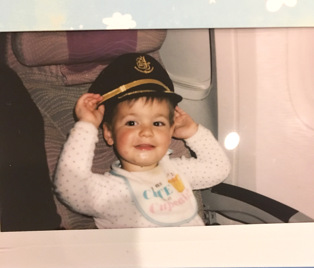 Our wonderful flight attendants on Emirates grabbed this Polaroid of Jack in the pilot's hat
